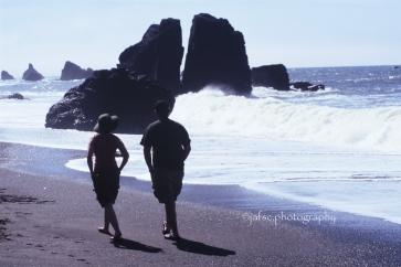 Walkers in a beach of California